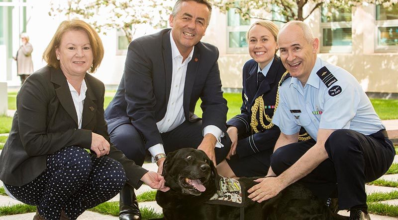 Squadron Leader Cindy Chawner, Darren Chester, Flight Lieutenant Sharne Kinleyside and Air Force Chaplain Col Barwise [dog not named, unfortunately]. Photo supplied.