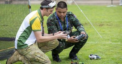 Australian Army soldier Lance Corporal Cameron Webster shows Royal Thai Army soldier Corporal Metha Yupanit how his drone works during the International Drone Racing Tournament at Victoria Barracks, Sydney. Photo by Able Seaman Tara Byrne.