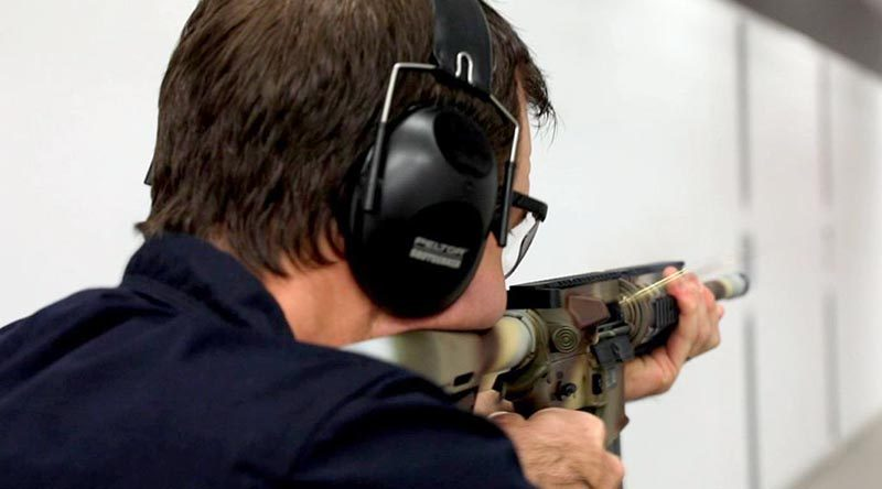 A NIOA employee goes full auto with a Colt M4A1-AU on the range to test the durability of EC Paint under extreme conditions. NIOA photo.