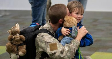 Corporal Hannah Bristow hugs her four-year-old son Leo after arriving home from the Sinai Peninsula. NZDF photo.