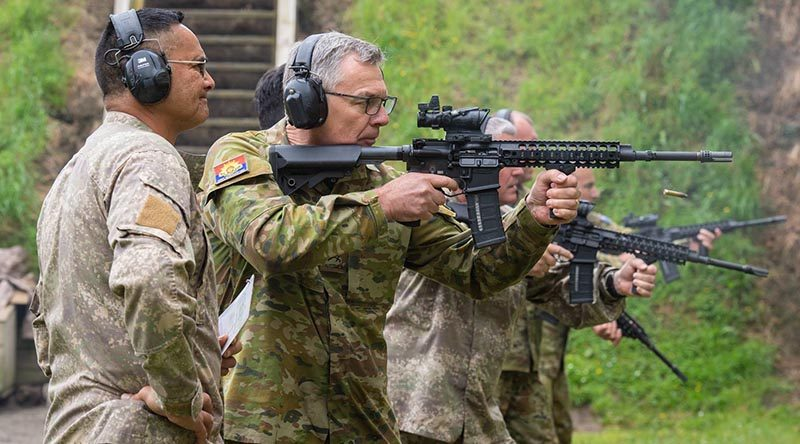 Australia's Chief of Army Lieutenant General Rick Burr showing good form on the range in New Zealand –his New Zealand counterpart Major General John Boswell partly obscured in the background. NZDF photo.
