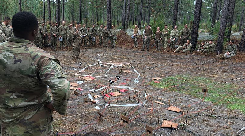 US and New Zealand soldiers listen to a situation briefing at the Joint Readiness Training Centre in Fort Polk, Louisiana. Photo supplied by NZDF.