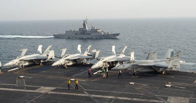 The Royal Australian Navy frigate HMAS Ballarat (FFH 155) sails alongside the aircraft carrier USS John C. Stennis (CVN 74) in the Arabian Gulf, Jan. 16, 2019, during exercise Intrepid Sentinel. Intrepid Sentinel brings together the John C. Stennis Strike Group, France's Marine Nationale, United Kingdom's Royal Navy and the Royal Australian Navy for a multinational exercise designed to enhance war fighting readiness and interoperability between allies and partners. The John C. Stennis Strike Group is deployed to the U.S. 5th Fleet area of operations in support of naval operations to ensure maritime stability and security in the Central Region, connecting the Mediterranean and the Pacific through the western Indian Ocean and three strategic choke points. (U.S. Navy photo by Mass Communication Specialist Seaman Jeffery L. Southerland)