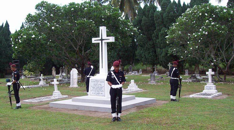 Malaysian Police guard the Cenotaph at Batu Gaja 2011