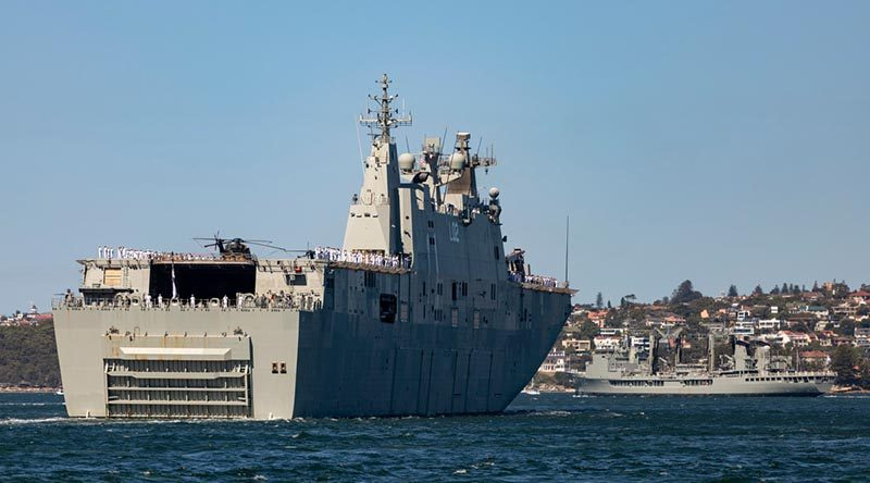 HMA Ships Canberra and Success depart Sydney Harbour (in company with HMAS Newcastle) for a four month deployment conducting training exercise and international engagement activities. Photo by Able Seaman Leo Baumgartner.