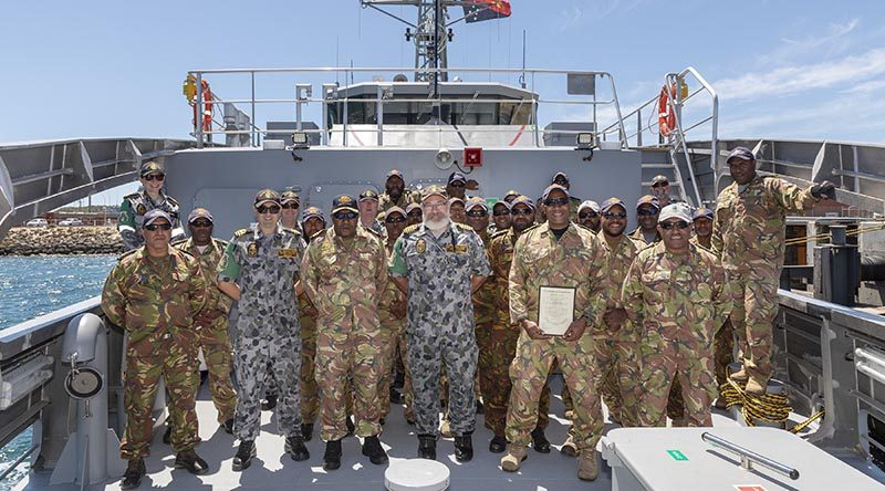 Members of the Royal Australian Navy Sea Training Group with the Papua New Guinea Defence Force Maritime Element ships company of 'Ted Diro' (P401) on completion of the ships sea readiness evaluation at HMAS Stirling in Western Australia. Photo by Able Seaman Christopher Szumlanski.