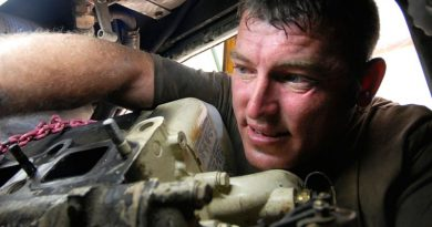Royal Australian Electrical and Mechanical Engineer vehicle mechanic Craftsman David Butler replacing a starter motor on an Australian Light Armoured Vehicle in Iraq. Photo by Corporal Rob Nyffenegger.