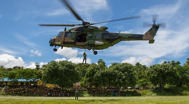 An MRH-90 helicopter from HMAS Choules' demonstrates handling and winching drills during a visit to Vanuatu. Choules will also visit Solomon Islands during her SW-Pacific Regional Engagement deployment. Photo by Petty Officer Justin Brown.