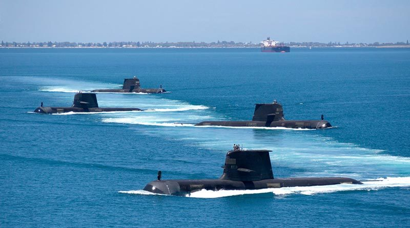 Collins-class submarines HMAS Collins, HMAS Farncomb, HMAS Dechaineux and HMAS Sheean transition through Cockburn Sound, Western Australia. Photo by Lieutenant Chris Prescott.