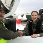 CCPL Kiera Galan (429 Squadron) is congratulated by SQNLDR Gary Presneill after completing her first solo flight on 18 April. Image by SQNLDR (AAFC) Scott Wiggins.
