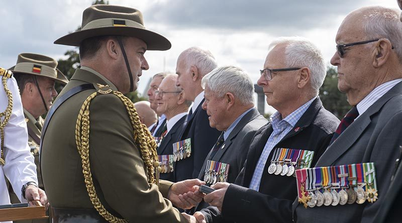Veterans from 161 Battery 16th Field Regiment, Royal New Zealand Artillery, receive an Australian Unit Citation for Gallantry at Linton Military Camp from Major General Gregory Bilton, Forces Commander Australian Army. NZDF photo.
