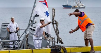 A sailor on HMAS Gascoyne throws a line to a Funafuti wharf worker as the ship pulls alongside in Tuvalu during a south-west-Pacific-engagement tour. Photo by Leading Seaman Craig Walton.