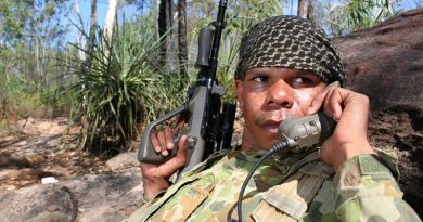North West Mobile Force soldier Private Corinthian Noketta from the Wallman Community in Turkey Creek radios information to command elements during a patrol activity on Operation Resolute on Groote Eylandt in the Gulf of Carpentaria. Photo by Gunner Shannon Joyce. 24 year-old Private Corinthian joined NORFORCE in 2001 and works as a signaller and coax man on water patrols. Private Corinthian is a Community Dole Project (CDP) participant at home, but wants to get training as a ranger to do more for his land. When Private Corinthian returns from patrol, the first thing he plans to do is roll out his 1980 Falcon Fairmont for a cruise around Katherine. Private Corinthian plays Australian Rules Football for Klarno.