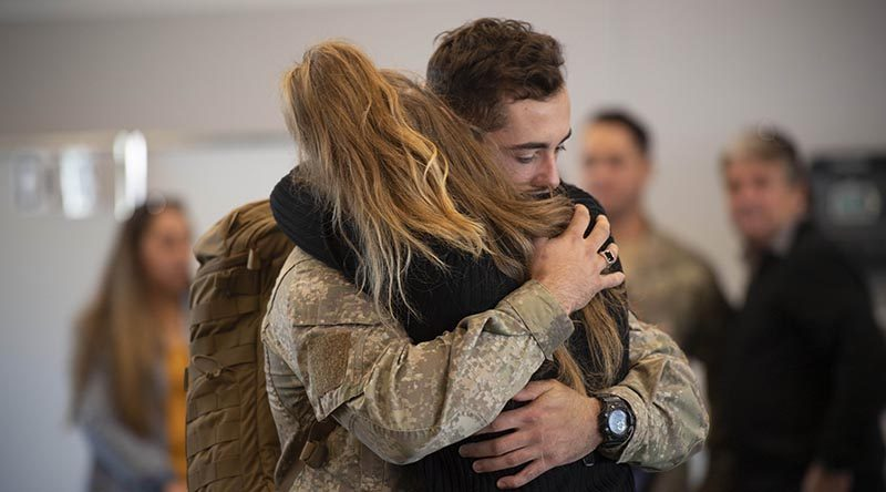 A New Zealand soldier bound for Operation Manawa 9 says good bye at RNZAF Base Ohakea Air Movements terminal. NZDF photo.