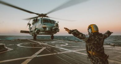 Leading Seaman Christy-Lee Doyle guides an MRH-60R Helicopter onto the flight deck of HMAS Toowoomba during unit readiness training. Photo by Leading Seaman Tara Byrne.