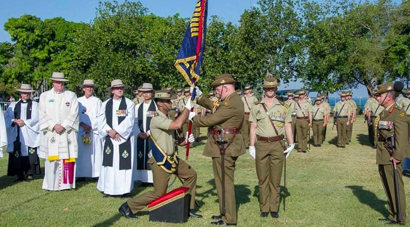 General Sir Peter Cosgrove, Governor General of Australia presents new Colours to 5RAR in Darwin, watched by Major General Mark Kelly, Colonel Commandant of The Royal Australian Regiment.