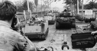 Centurion tanks from 1st Armoured Regiment, and armoured personnel carriers from B Squadron, 3rd Cavalry Regiment, move along the main road of Binh Ba village. Over three days, armour and infantry dislodged a strong North Vietnamese Army group that had entered the village, for the loss of one Australian killed in action. AWM BEL/69/0389/VN. Binh Ba.