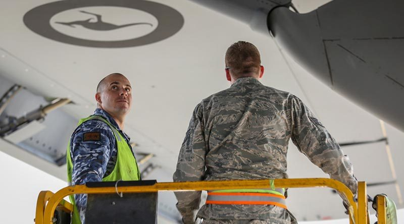 USAF and RAAF C-17 maintainers work together on a RAAF C-17A Globemaster III. Photo by Corporal Brenton Kwaterski.