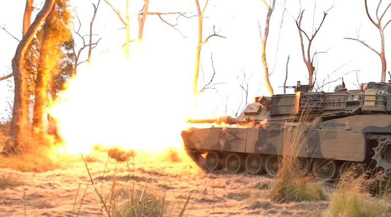 An Australian Army M1A1 Abrams fires in bushland at Shoalwater Bay Training Area, Queensland.