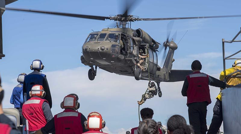 Colombian Marines fast-rope onto the flight deck of Whidbey Island-class Dock Landing Ship USS Gunston Hall during UNITAS 2018. US Navy photo by Mass Communication Specialist 3rd Class Colbey Livingston.