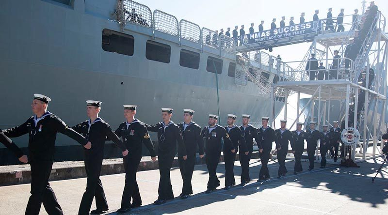 Ship's company of HMAS Success march off the ship for the last time during her decommissioning ceremony at Fleet Base East, Sydney. Photo by Chief Petty Officer Cameron Martin.
