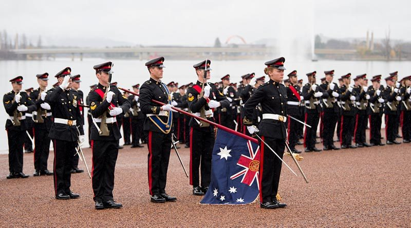 Royal Military College Corps of Staff Cadets and the Colour Party giving a Royal Salute during the annual Queen's Birthday Parade at Rond Terrace, Canberra. Photo by Grace Costa Banson.