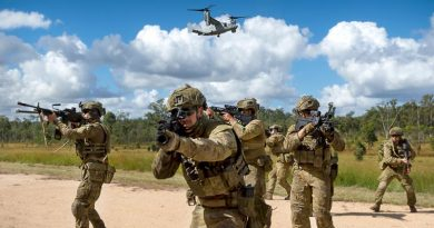 Australian Army riflemen from the 6th Battalion, Royal Australian Regiment, conduct a simulated assault with United States Marine Corps MV-22 Osprey support at Shoalwater Bay Training Area. Photo by Corporal Tristan Kennedy.