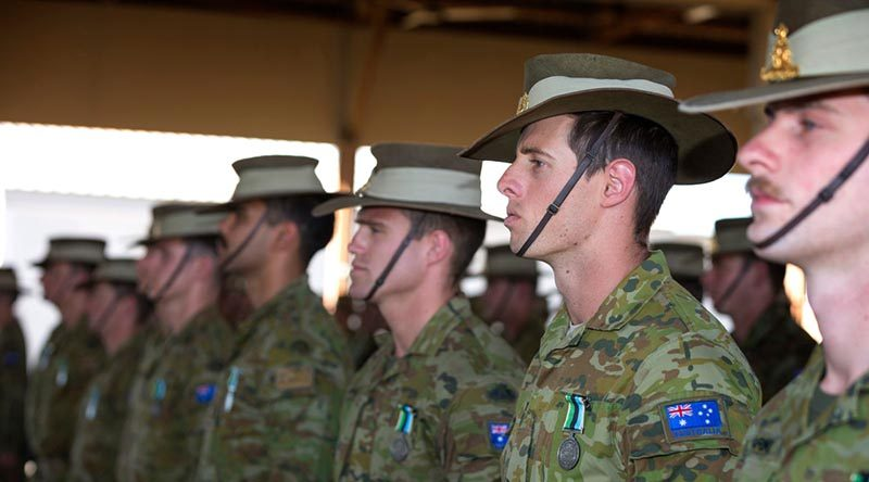 Australian Army soldiers of Task Group Taji 8 on parade after receiving their mission medals at the Taji Military Complex, Iraq. Photo by Corporal Oliver Carter.