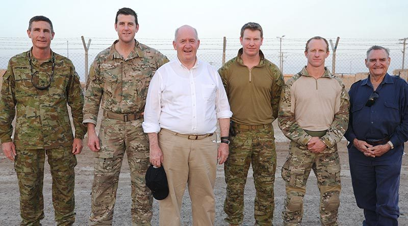 Governor-General Sir Peter Cosgrove with Australian Victoria Cross recipients (from right), Keith Payne VC, Corporal Mark Donaldson VC, Corporal Daniel Keighran VC and Corporal Ben Roberts-Smith VC MG, and then Chief of Army Lieutenant General Angus Campbell, on a visit to Australian troops in Baghdad, Iraq (August 2015).