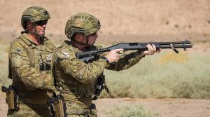 Sergeant Nicholas Cope supervises Private Richard Collins during a shotgun familiarisation serial at Taji Military Complex, Iraq. Photo by Corporal Nunu Campos.