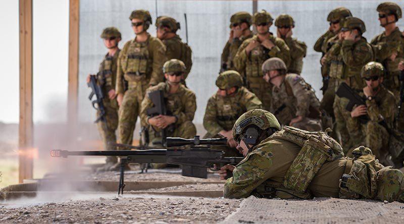 Australian Army Corporal Bradley Rawnsley, deployed with Task Group Taji 9, fires an AW50 sniper rifle duringweapons familiarisation drillsat the Taji Military Complex, Iraq. Photo by Corporal Nunu Campos.