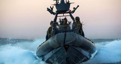 2nd Commando Regiment commandos speed towards a 'target' vessel in a rigid-hulled inflatable boat (RHIB) during counter-terrorism training off the New South Wales coast. Photo by Corporal Sebastian Beurich.