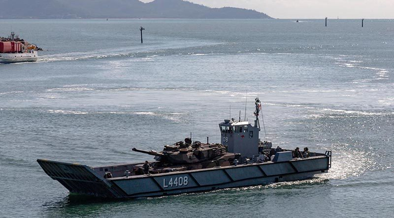 An LHD landing craft carries an M1A1 Abrams tank in Townsville Harbour during post-upgrade trials. Royal Australian Navy Photo.