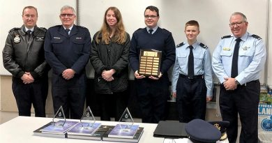 "CAPTION: The ""Fly High Sci Fi"" team from 617 Squadron receive their National Aerospace Competition award (left to right): FLGOFF(AAFC) Chris Trewin (Commanding Officer, 617 Squadron), GPCAPT Warren Bishop (Competition Manager), LCDT Stephanie Hudson, CWOFF Ian van Schalkwyk, CCPL James Armfield and WGCDR(AAFC) Patrick Pulis (Officer Commanding, 6 Wing). Image supplied by Air Force."