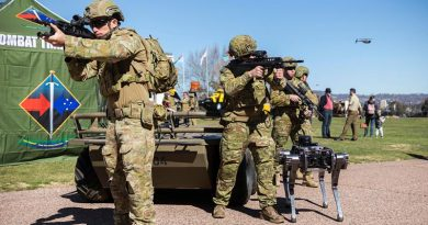 Australian Army soldiers from the Combat Training Centre are joined by Mule (rear) and Ghostrobotics (right) unmanned ground vehicles, as well as a Black Hornet nano UAV in a display of human-machine teaming during Army Demonstration Day at Russel Offices. Photo by Corporal Sebastian Beurich.