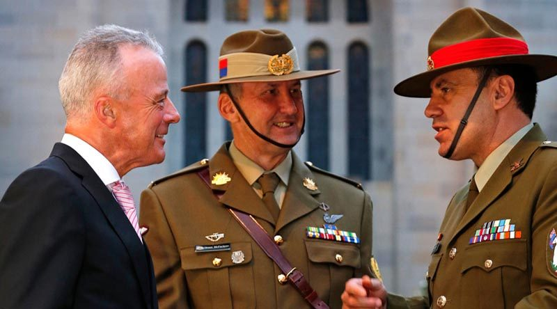 Director of the Australian War Memorial Brendan Nelson speaks with Sergeant Major of the New Zealand Army Warrant Officer Class One Clive Douglas as Regimental Sergeant Major of the Australian Army Warrant Officer Grant McFarlane watches on. Photo by Corporal Veronica O'Hara.