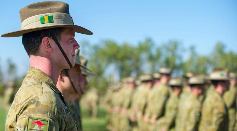 A 5th Battalion, Royal Australian Regiment, soldier stands at ease during a farewell parade for troops heading to the Middle East, at Robertson Barracks, NT. Photo by Corporal Carla Armenti.