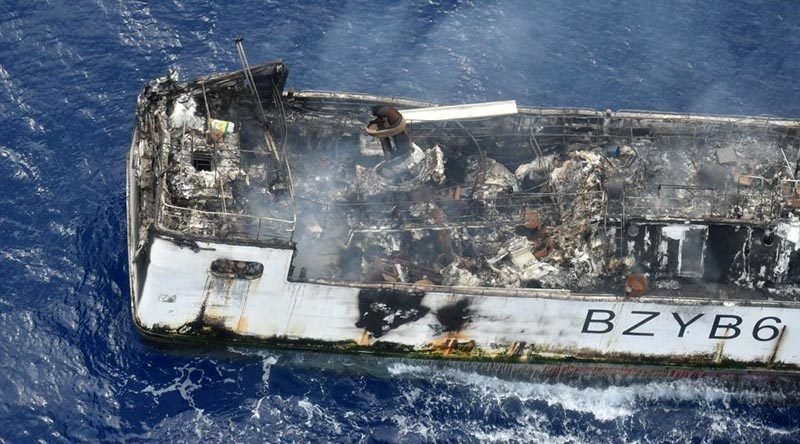 A Royal New Zealand Air Force P-3K2 Orion photographs the Chinese fishing vessel Jin Xiang 6, damaged by fire west of Tuvalu. NZDF photo.