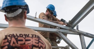 Australian Army carpenter Sapper David Mikic from 1st Combat Engineer Regiment fixes purlins to steel frames at Metinaro Military Base, Timor-Leste, during Exercise Hari'i Hamutuk 2016. Photo by Corporal Nunu Campos.