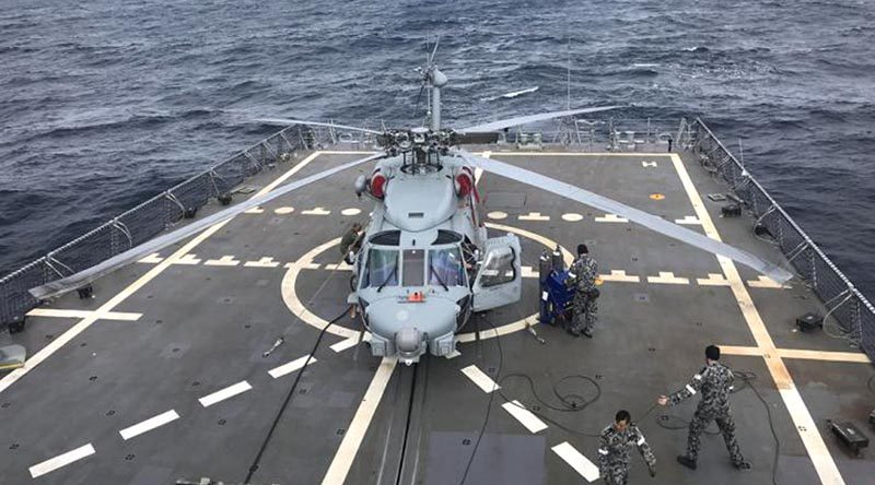 HMAS Hobart's embarked MR-60R helicopter 'COBRA 16' during first-of-class flight trials off the east coast off Australia. Photo by Lieutenant Commander Sidney Raper.