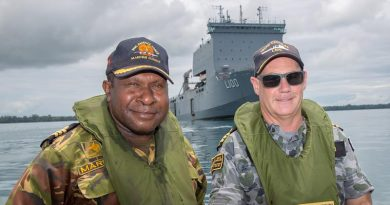 Commander Sebastian Marru of the Papua New Guinea Defence Force Maritime Element, and the Commanding Officer HMAS Choules Commander Scott Houlihan at Tarangau Naval base, Manus Island. Photo by Petty Officer Justin Brown.