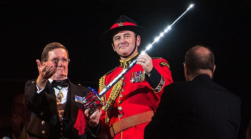 Major Graham Hickman of the New Zealand Army Band, right, receives the Pooley Sword at the final show of the 2019 Royal Edinburgh Military Tattoo. Photo courtesy The Royal Edinburgh Military Tattoo.