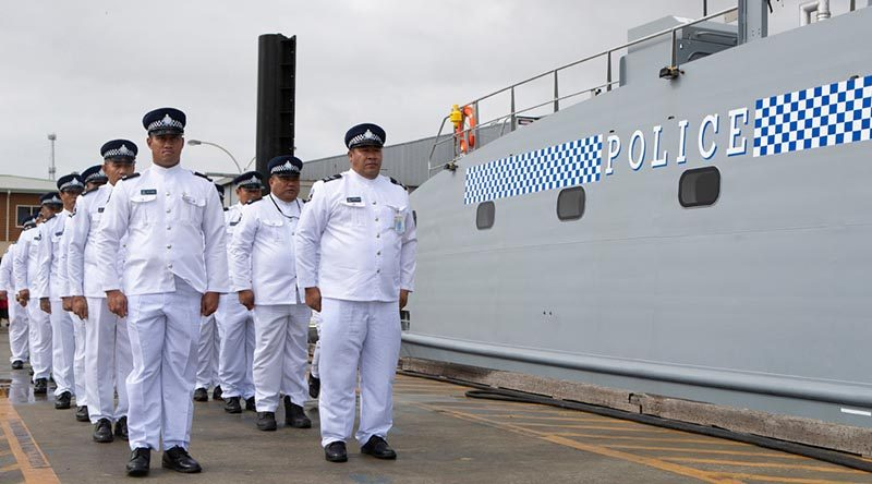 Samoan Police crew of Nafanua II fall in alongside their newly aquired Guardian-class patrol boat at Austal ship yards in Henderson, Western Australia. Photo by Leading Seaman Richard Cordell.