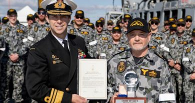 Chief of Navy, Vice Admiral Michael Noonan presents Warrant Officer Paul Ross with a Commendation and Innovation award in front Submarine Force personnel on Diamantina Pier at Fleet Base West, Western Australia. Photo by Leading Seaman Richard Cordell.
