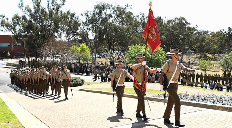 The retired Australian Army Banner is paraded for the last time at Army Recruit Training Centre, Kapooka, NSW, before being laid up in the Blamey Barracks Soldier's Chapel. Photographer unknown.