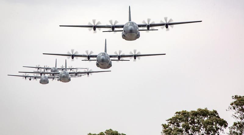 C-130J Hercules aircraft from No.37 Squadron fly in formation over RAAF Base Richmond. Photo by Corporal Craig Barrett.