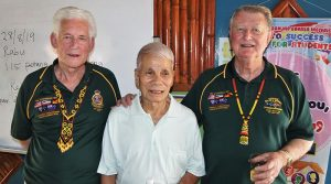 President of the SA/NT Branch NMBVAA Brian Selby (right) and Vice-President Don Cameron at Sekolah Kebangsaan Stass, with Abang, who supported the Australians as an Iban Tracker during Confrontation.
