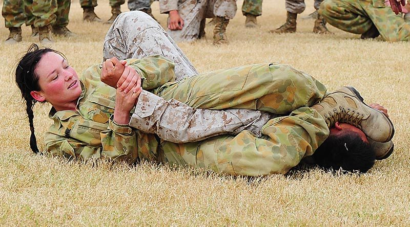 Australian Army Corporal Casey Bone, 1st Aviation Regiment, gets the upper-hand on a US Marine Corps opponent during the unarmed combat practise during Exercise Talisman Sabre 2011. Photo by Leading Seaman Andrew Dakin.
