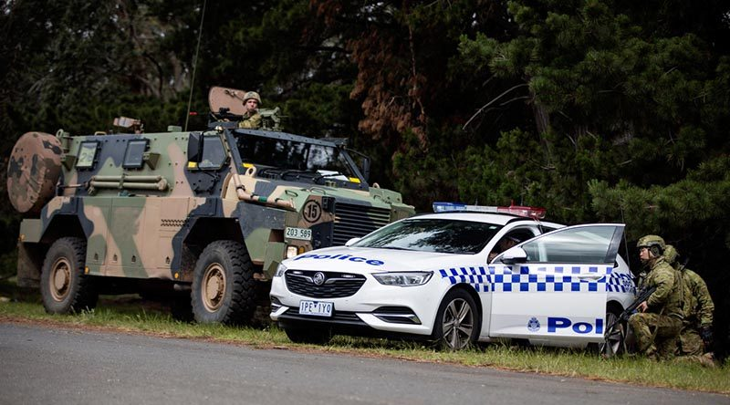 Australian soldiers provide support to the Victoria Police during a training scenario on Exercise Austral Shield 2019. Photo by Corporal Jessica de Rouw.