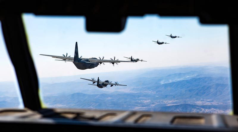 Five No 37 Squadron C-130J Hercules fly in formation to celebrate 20 years of C-130J operations in Australia. Photo by Corporal David Said.